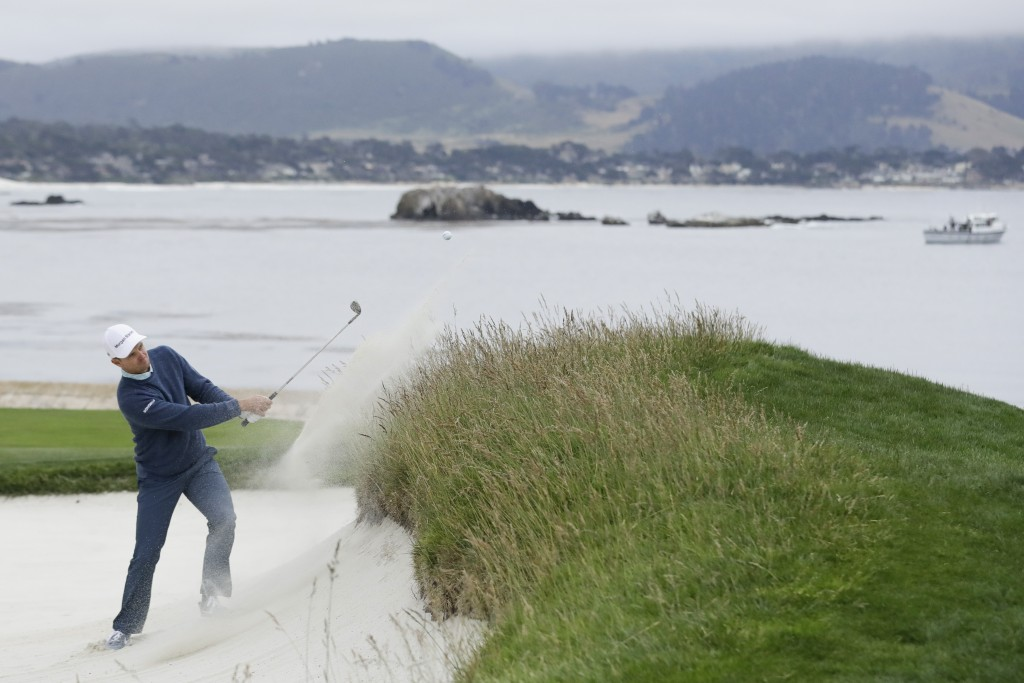 Justin Rose, of England, hits out of the bunker on the 18th hole during the third round of the U.S. Open golf tournament Saturday, June 15, 2019, in P...