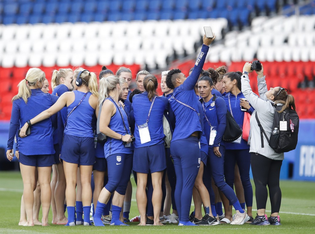 United States' players take photos during a visit at the Parc des Princes stadium a day before the Group F soccer match between United States and Chil...