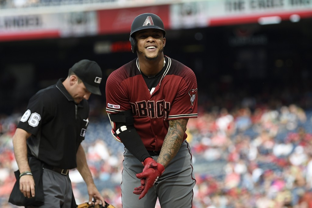 Arizona Diamondbacks' Ketel Marte celebrates his home run during the fourth inning of a baseball game against the Washington Nationals, Saturday, June...