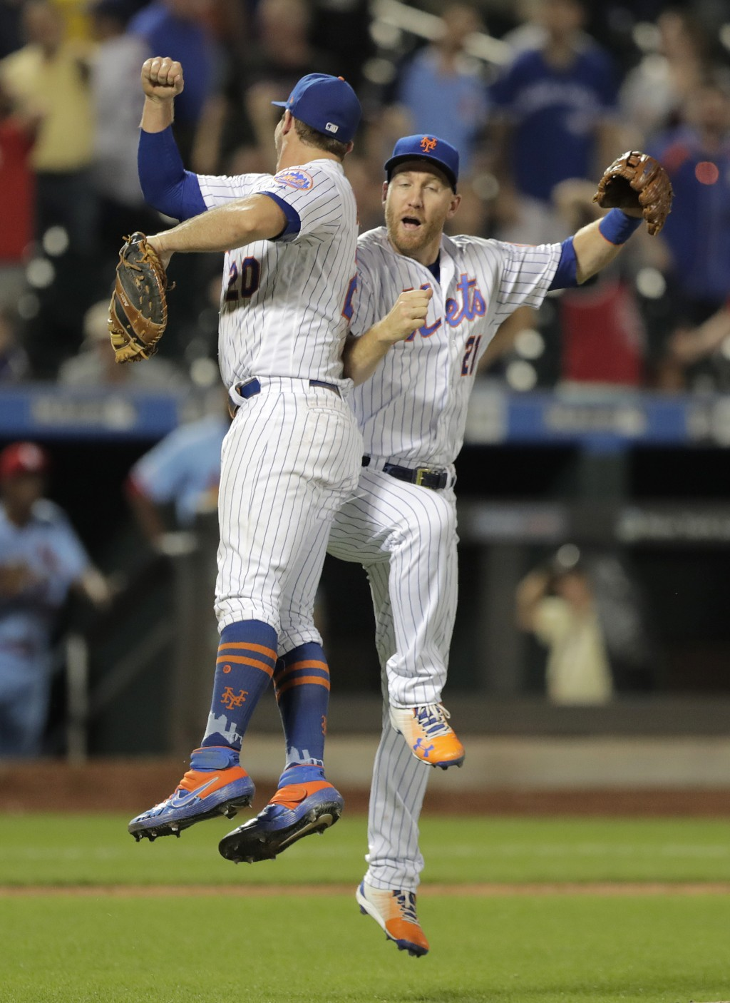 New York Mets first baseman Pete Alonso, left, and third baseman Todd Frazier celebrate after the Mets defeated the St. Louis Cardinals 8-7 during a b