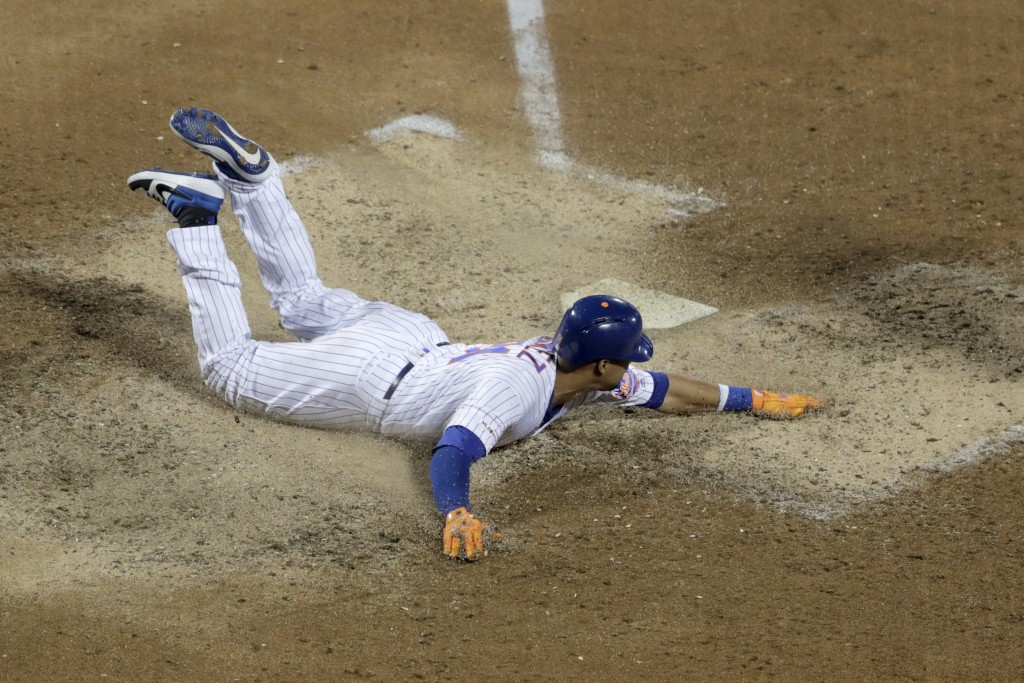 New York Mets' Carlos Gomez scores on a single by Michael Conforto off St. Louis Cardinals relief pitcher Genesis Cabrera during the sixth inning of a...