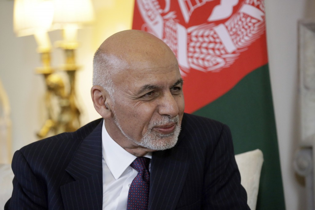 Afghanistan's President Ashraf Ghani speaks with British Prime Minister Theresa May at the start of their meeting inside 10 Downing Street in London, ...
