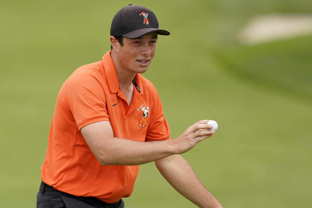 Amateur player, Viktor Hovland, of Norway, waves after his birdie putt on the sixth hole during the final round of the U.S. Open Championship golf tou...