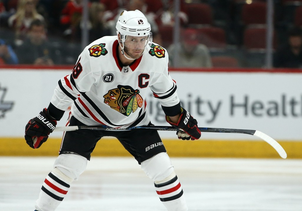 FILE - In this March 26, 2019, file photo, Chicago Blackhawks center Jonathan Toews pauses during the first period of an NHL hockey game against the A...