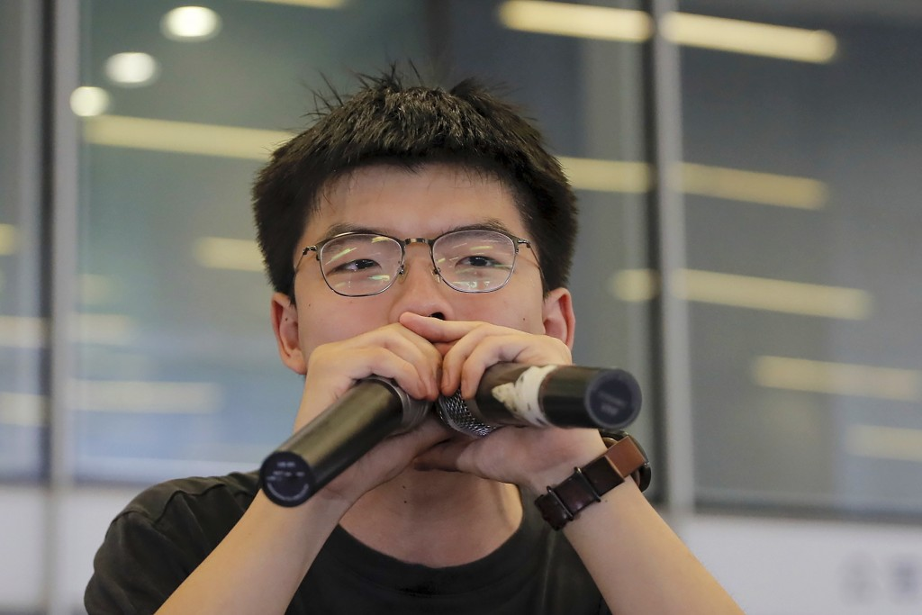 Pro-democracy activist Joshua Wong speaks to protesters near the Legislative Council following a massive protest against the unpopular extradition bil