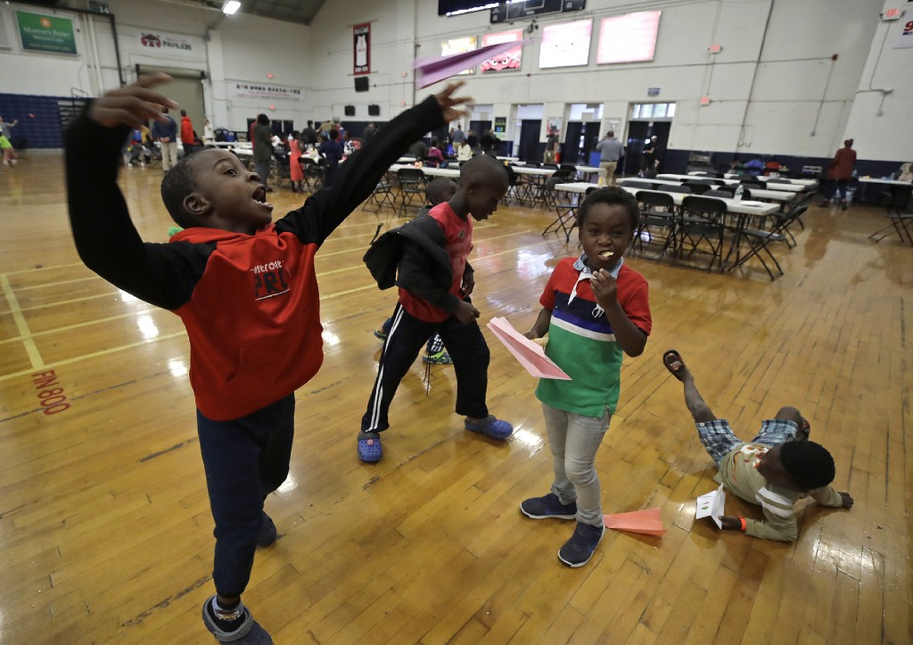 In this June 13, 2019 photo, migrant children play inside the Portland Exposition Building in Portland, Maine. Maine's largest city has repurposed the...
