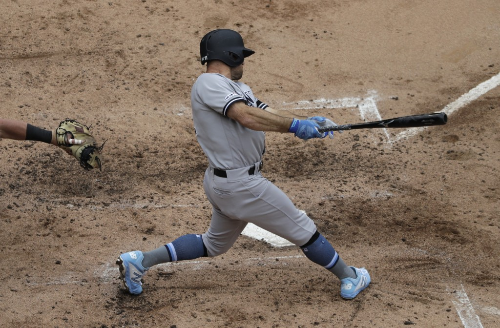 New York Yankees' Brett Gardner hits a two-run single against the Chicago White Sox during the third inning of a baseball game in Chicago, Sunday, Jun...