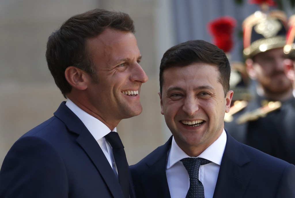 French President Emmanuel Macron, left, greets Ukrainian President Volodymyr Zelenskiy before a meeting at the Elysee Palace, in Paris, Monday, June 1
