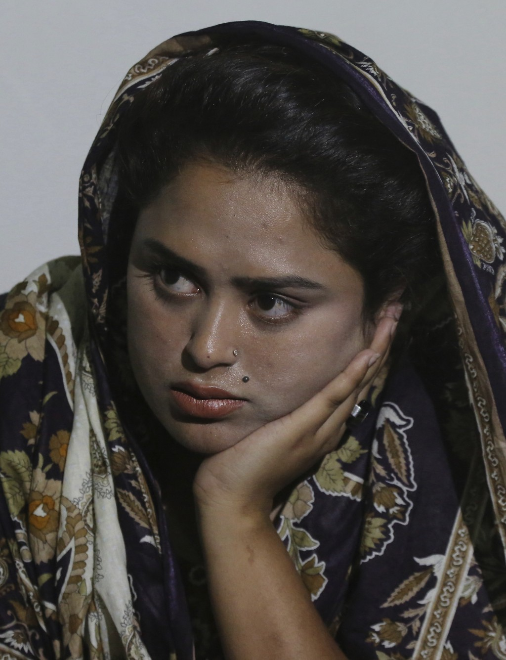 In this May 14, 2019, photo, Pakistani Christian Natasha Masih, speaks to the Associated Press in Faisalabad, Pakistan. Natasha begged her mother to b...