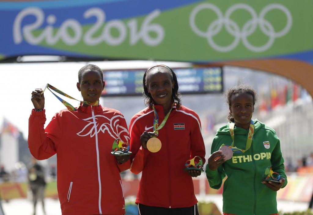 FILE - In this Sunday, Aug. 14, 2016 file photo, silver medalist Eunice Jepkirui Kirwa, of Bahrain, left, gold medalist Jemima Jelagat Sumgong, of Ken