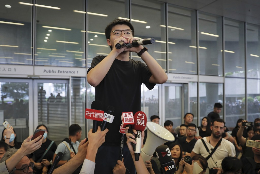 Pro-democracy activist Joshua Wong speaks to protesters near the Legislative Council in Hong Kong, Monday, June 17, 2019. Wong, a leading figure in Ho...