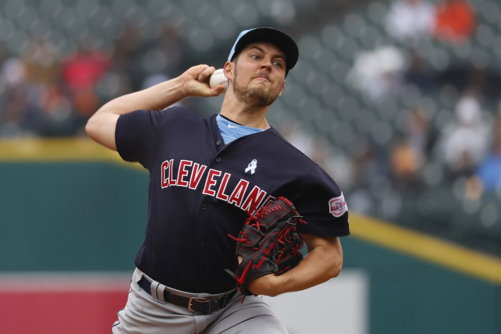Cleveland Indians pitcher Trevor Bauer throws in the seventh inning of a baseball game against the Detroit Tigers in Detroit, Sunday, June 16, 2019. (