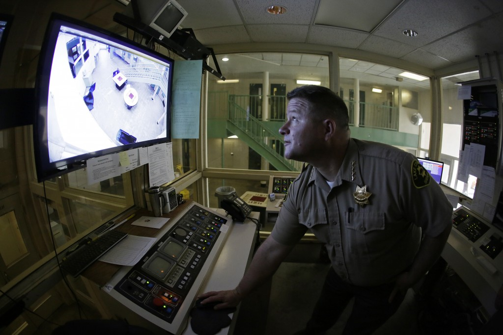 Sheriff Brian Martin looks at a video monitor in a control area of the Lake County Jail in Lakeport, Calif., on Tuesday, April 16, 2019. The sheriff i