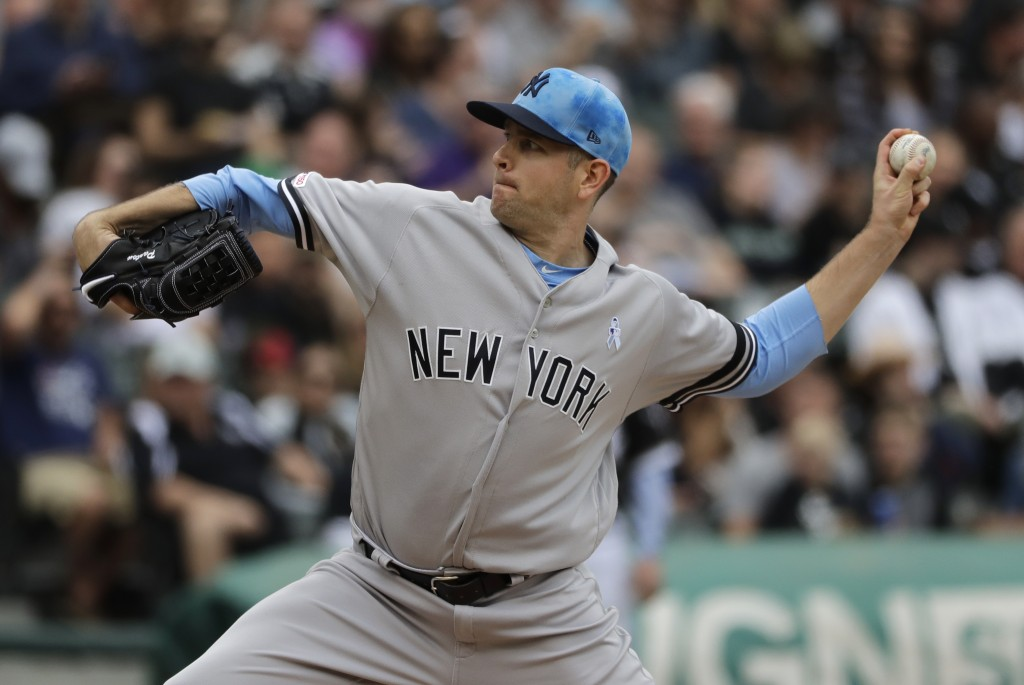 New York Yankees starting pitcher James Paxton throws against the Chicago White Sox during the first inning of a baseball game in Chicago, Sunday, Jun