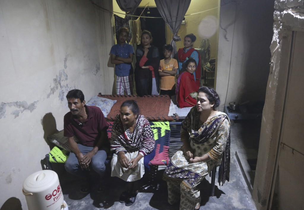 In this May 14, 2019, photo Pakistani Christian Natasha Masih, right front, sits with her family members during an interview in Faisalabad, Pakistan. ...