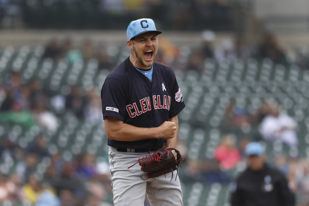 Cleveland Indians pitcher Trevor Bauer reacts to striking out Detroit Tiger's Brandon Dixon in the ninth inning of a baseball game in Detroit, Sunday,