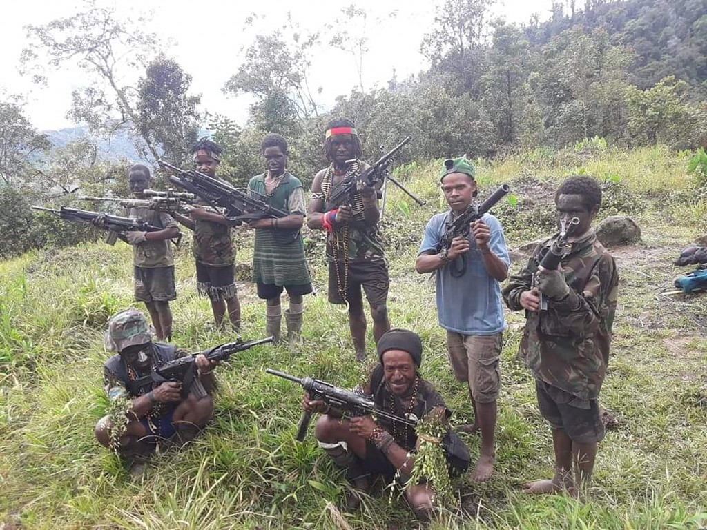 In this photo taken in May 2019, and released by the West Papua Liberation Army-Free Papua Organization, men and boys from the West Papua Liberation A...