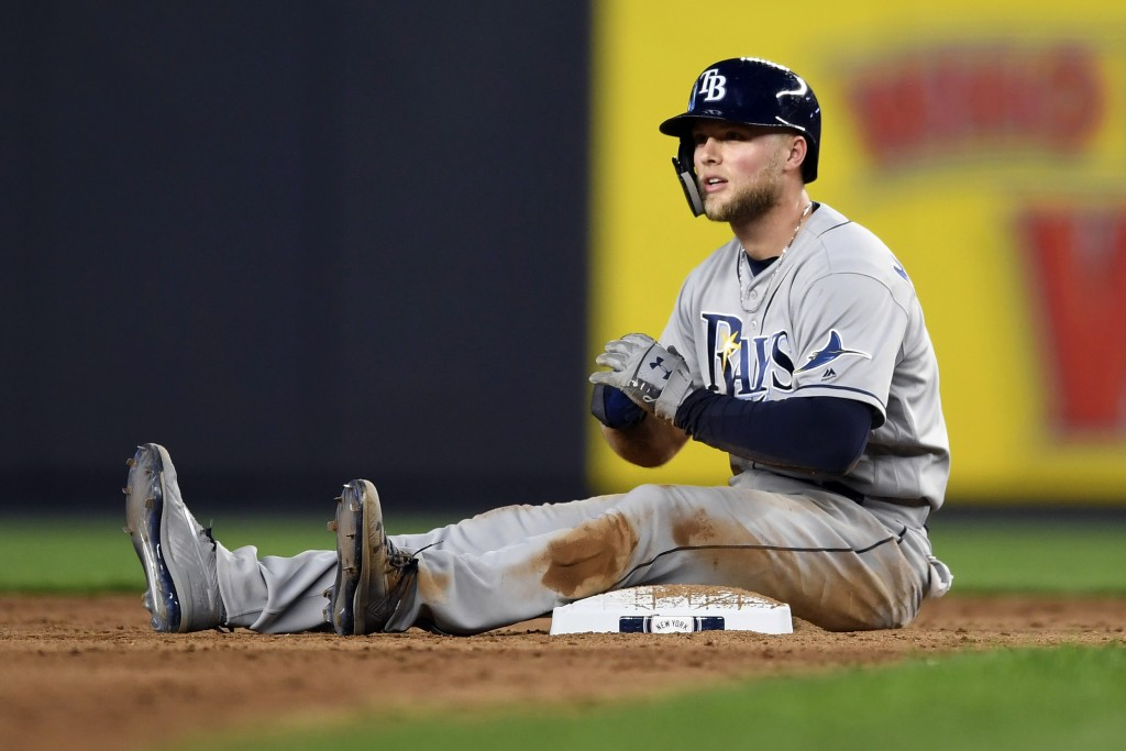 Tampa Bay Rays' Austin Meadows reacts after being caught while trying to steal second by New York Yankees second baseman Gleyber Torres during the six...