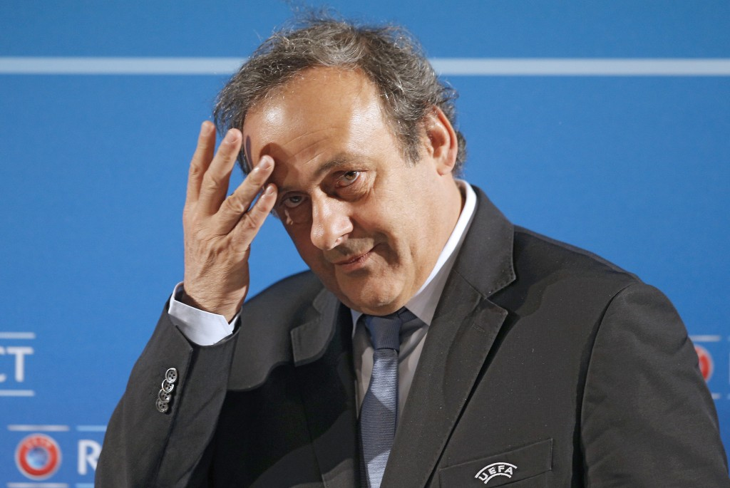 FILE - In this Feb.22, 2014 file photo, UEFA President Michel Platini arrives at a press conference, one day prior to the UEFA EURO 2016 qualifying dr
