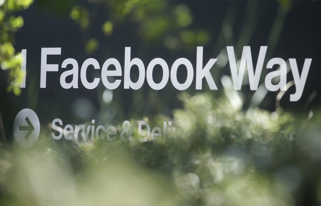 FILE - In this April 25, 2019, file photo an address sign for Facebook Way is shown in Menlo Park, Calif. Facebook unveiled a broad plan Tuesday, June...