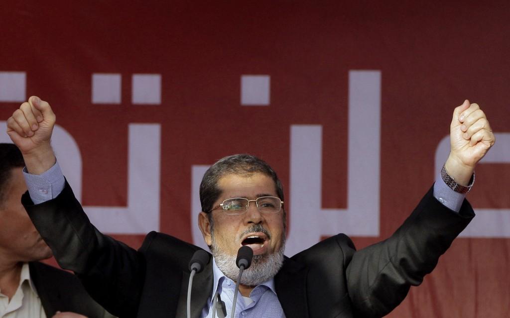 FILE - In this June 29, 2012 file photo, Egypt's then President-elect Mohammed Morsi talks to his supporters at Tahrir Square, in Cairo, Egypt. On Mon
