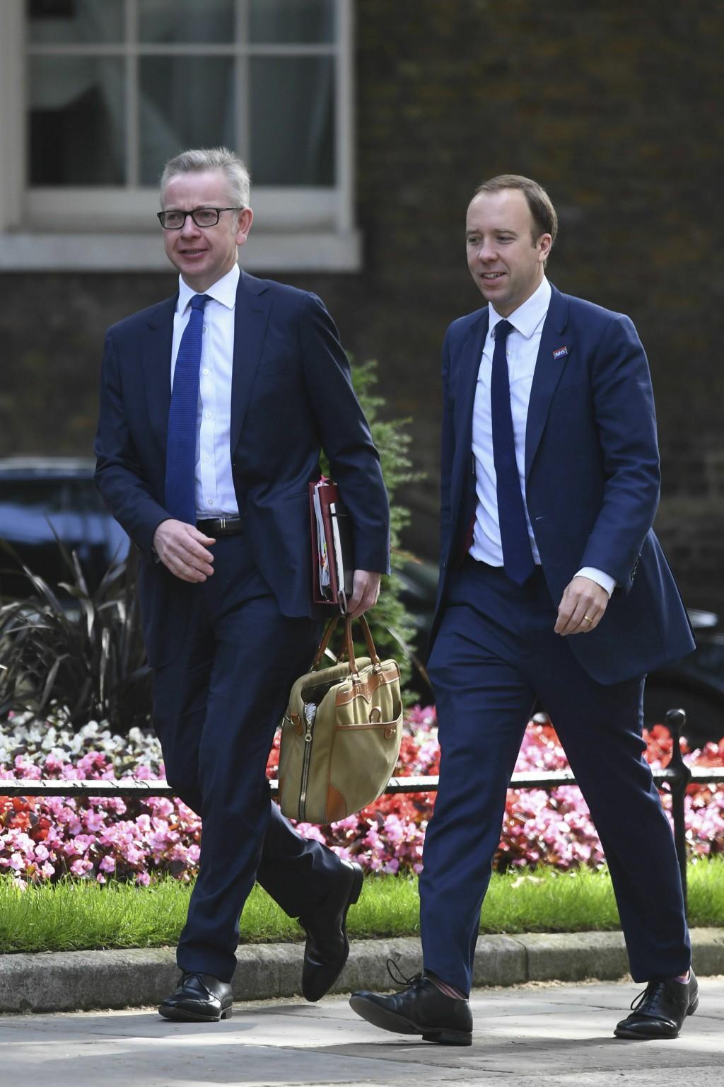 Britain's Environment Secretary Michael Gove, left, and Health Secretary Matt Hancock arrive for a cabinet meeting at 10 Downing Street, London, Tuesd...