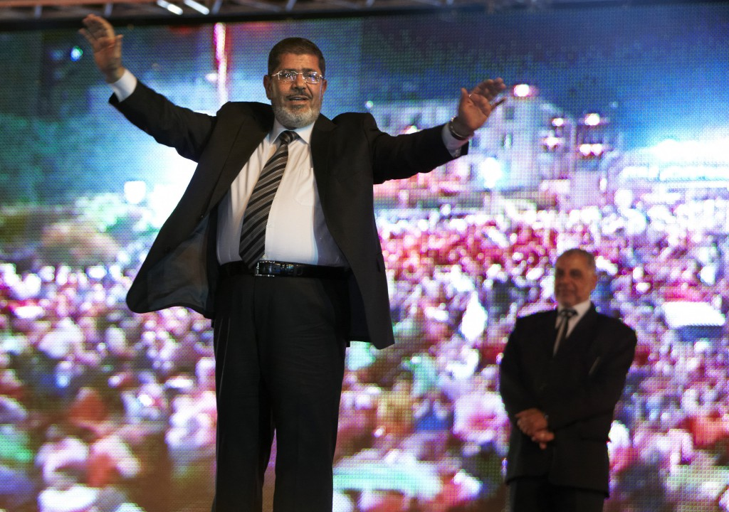 FILE - In this May 20, 2012 file photo, then Muslim Brotherhood's presidential candidate Mohammed Morsi holds a rally in Cairo, Egypt. On Monday June