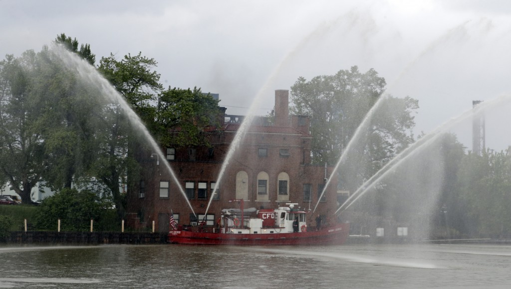The Anthony J. Celebrezze turns on its hoses in front of Fire Station 21 on the Cuyahoga River, Thursday, June 13, 2019, in Cleveland. Fire Station 21