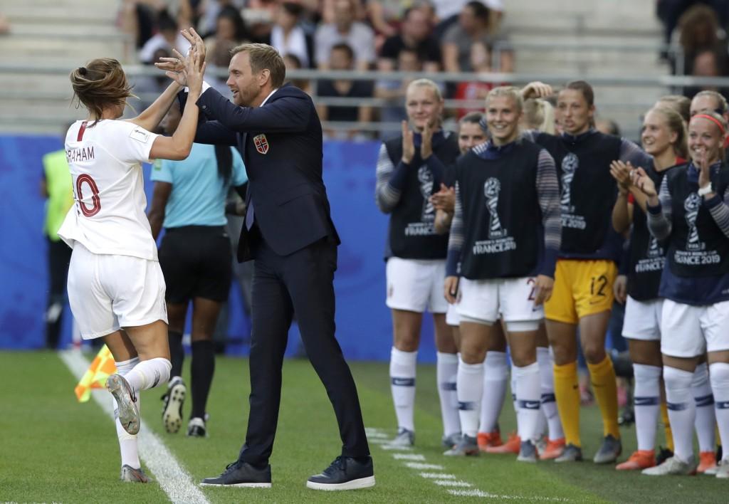Norway's Caroline Graham Hansen, left, is congratulated by Norway coach Martin Sjogren after scoring her team's first goal during the Women's World Cu...