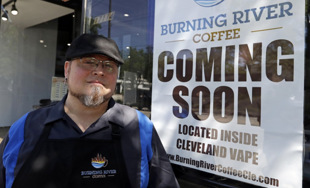 Johnny Rowan stands outside Burning River Coffee, Friday, June 14, 2019, in Lakewood, Ohio. Rowan's is one of 90 active businesses registered with the