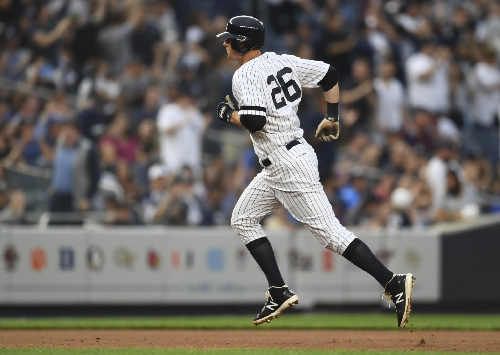 New York Yankees' DJ LeMahieu (26) runs to third base after hitting a two-run home run during the third inning of a baseball game against the Tampa Ba...