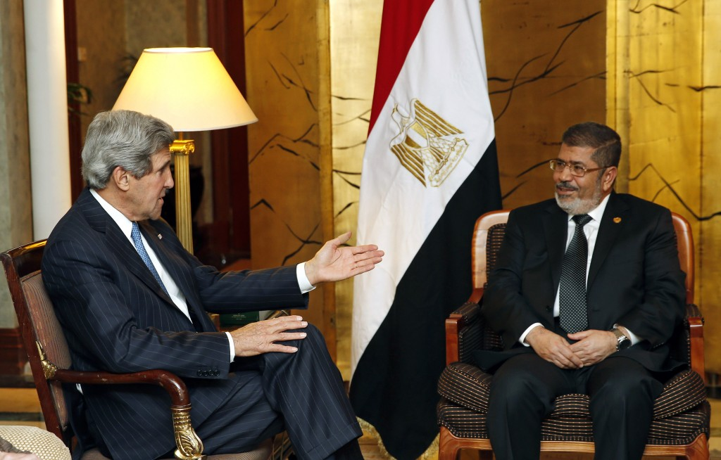FILE - In this May 25, 2013 file photo, U.S. Secretary of State John Kerry, left, meets with Egyptian President Mohammed Morsi in Addis Ababa, Ethiopi