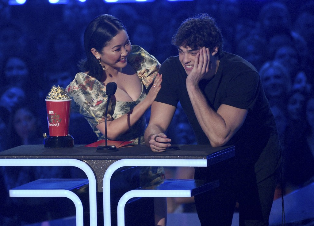 "Lana Condor, left, and Noah Centineo accept the award for best kiss for ""To All the Boys I've Loved Before"" at the MTV Movie and TV Awards on Saturday"