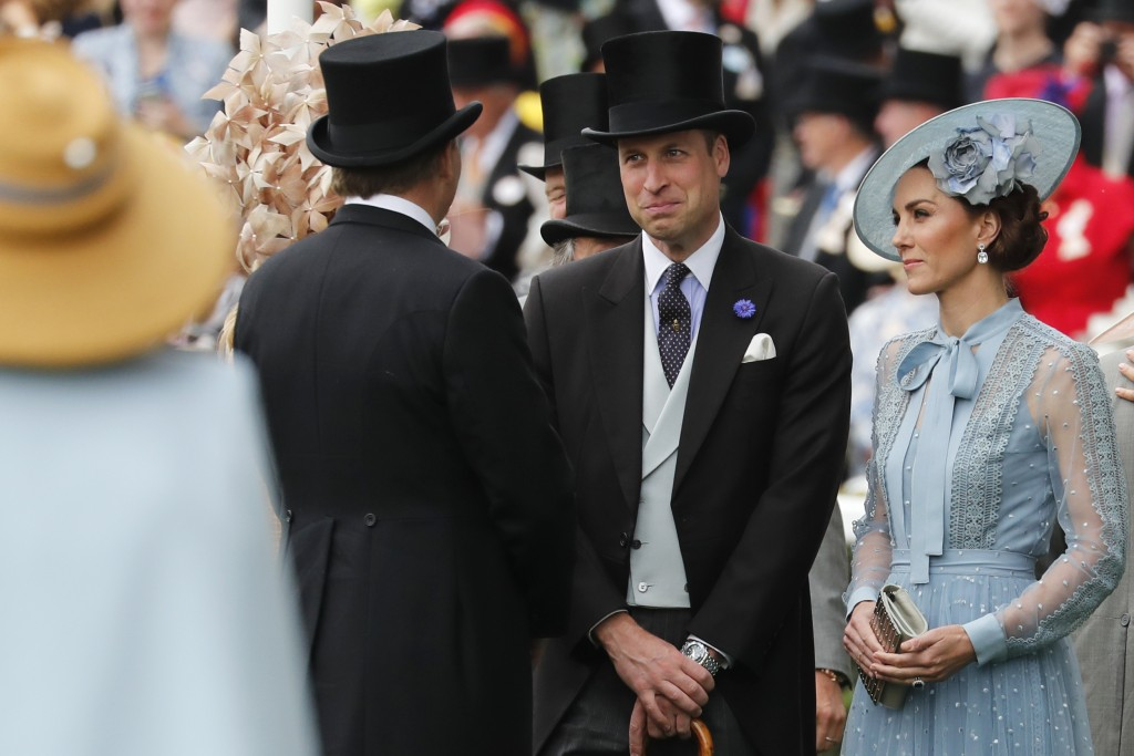 Kate, Duchess of Cambridge, right, and Prince William arrive on the day one of the annual Royal Ascot horse race meeting in Ascot, England, Tuesday, J...