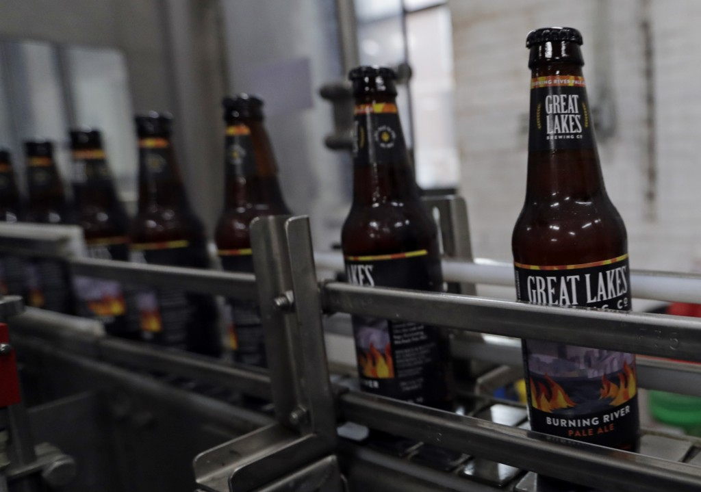 Bottles of Burning River beer make their way down the assembly line in the bottling process at the Great Lakes Brewing Company, Monday, June 17, 2019,
