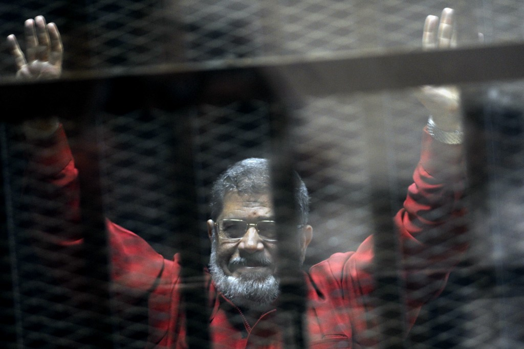 FILE - In this June 21, 2015 file photo, former Egyptian President Mohammed Morsi, wearing a red jumpsuit that designates he has been sentenced to dea
