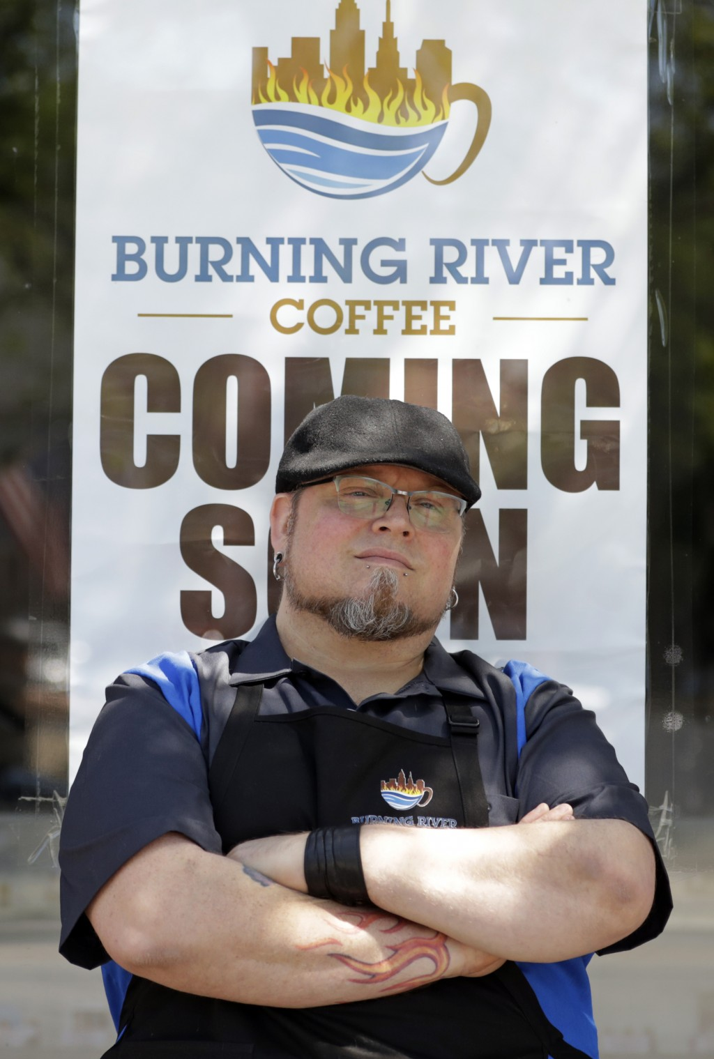 Johnny Rowan stands outside Burning River Coffee, ...