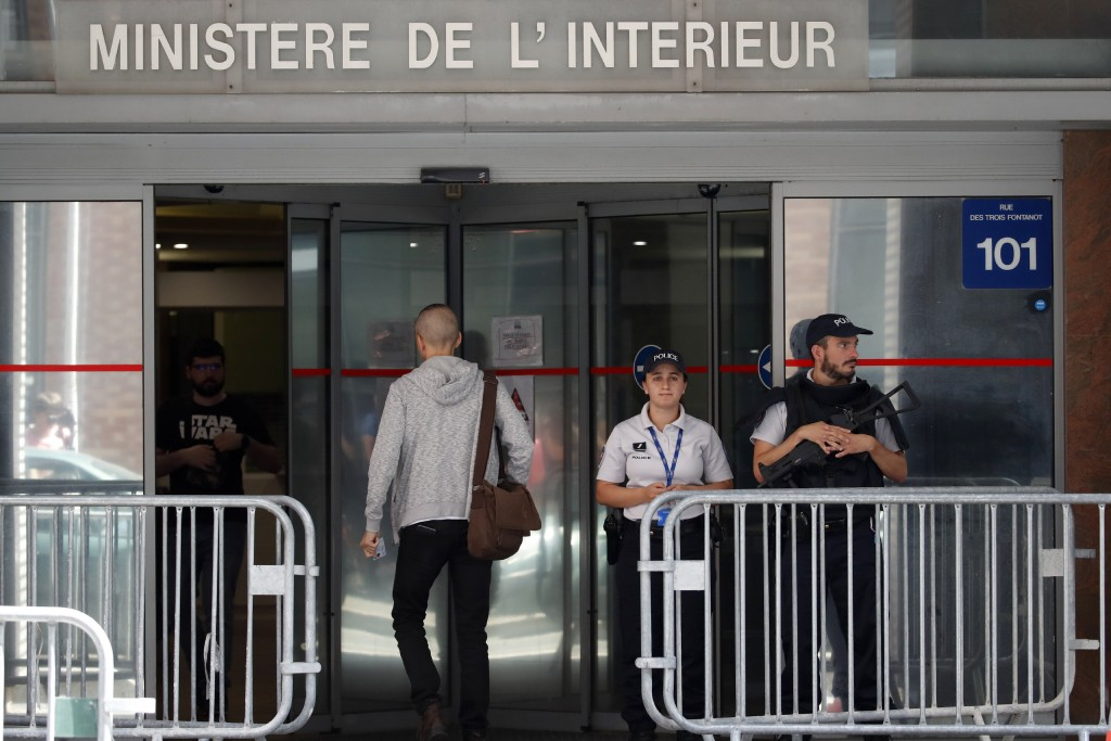 Police officers guard the Anti-Corruption Office of the Judicial Police headquarters in Nanterre, outside Paris,Tuesday, June 18, 2019. Former UEFA pr...