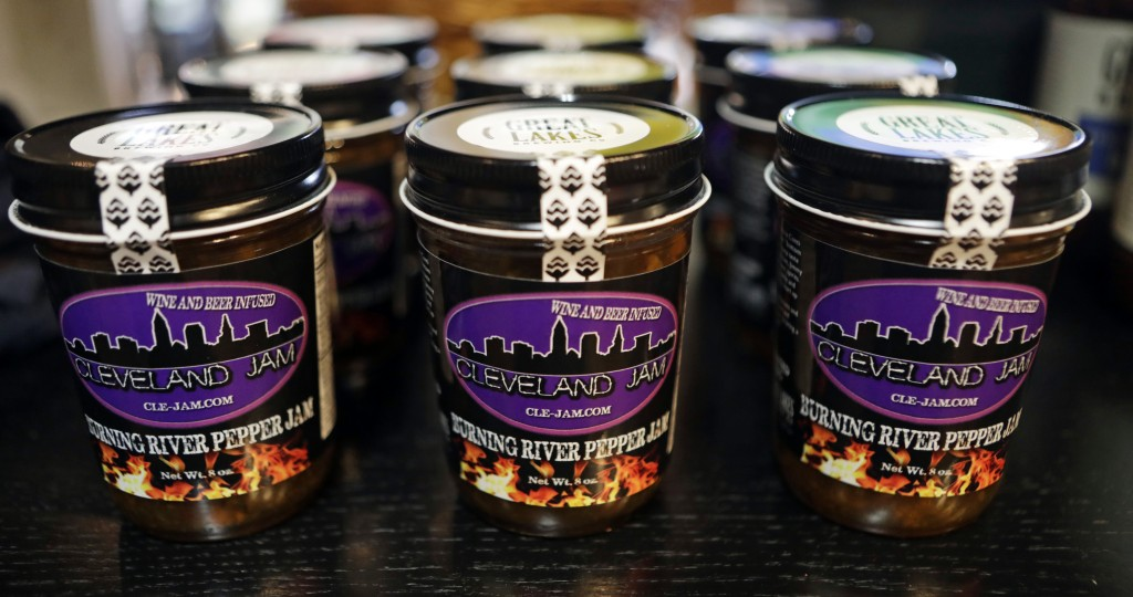 """Burning River Pepper Jam is displayed on a shelf at the Great Lakes Brewing Company gift shop, Monday, June 17, 2019, in Cleveland. The """"burning river"""