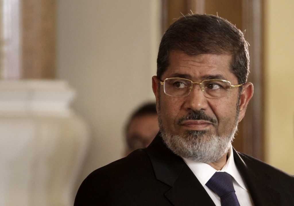 FILE - In this July 13, 2012 photo, Egyptian President Mohammed Morsi holds a news conference with Tunisian President Moncef Marzouki, at the Presiden