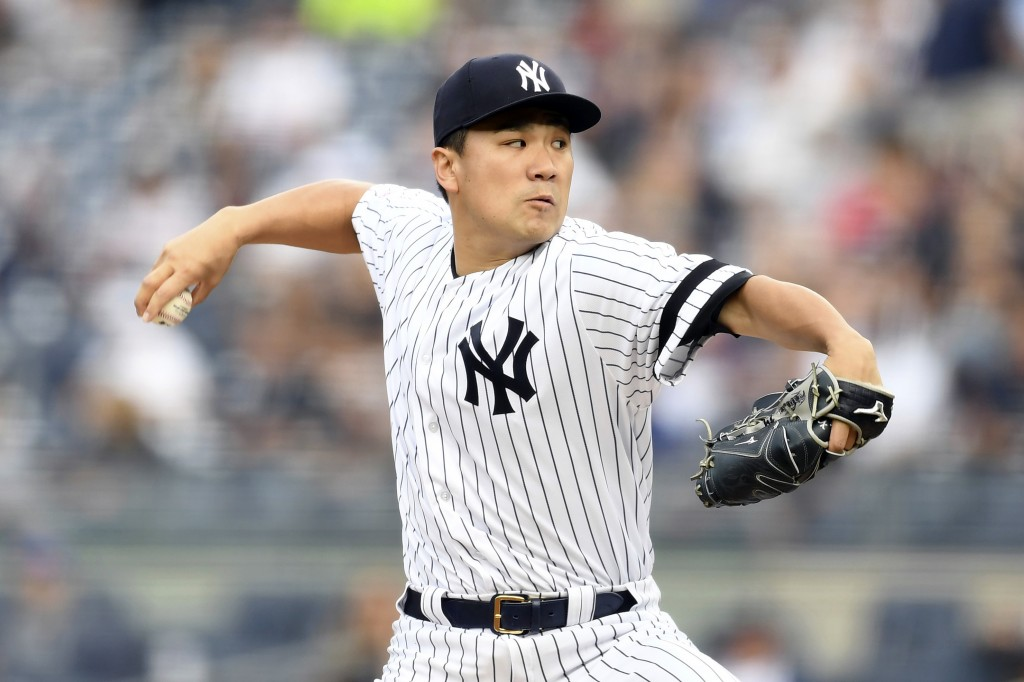 New York Yankees starting pitcher Masahiro Tanaka delivers during the first inning of a baseball game against the Tampa Bay Rays, Monday, June 17, 201...