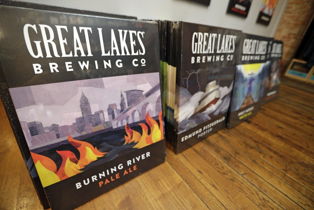 Posters are for sale featuring Burning River Pale Ale at the gift shop at the Great Lakes Brewing Company, Monday, June 17, 2019, in Cleveland. Fifty
