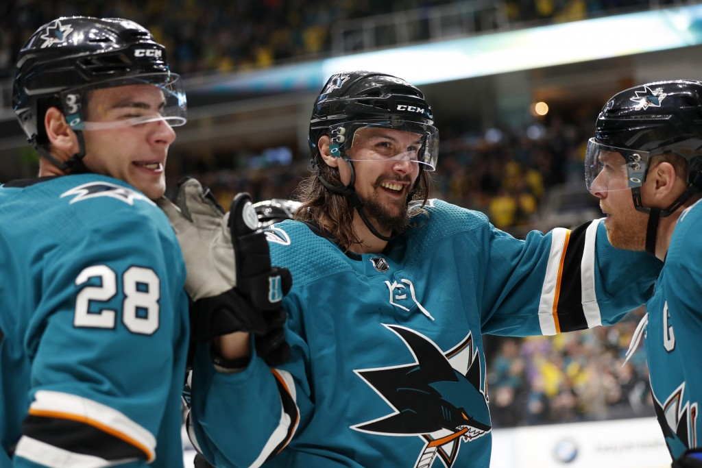 FILE - In this Feb. 16, 2019, file photo, San Jose Sharks' Erik Karlsson, center, celebrates with Timo Meier, left, and Joe Pavelski after Pavelski sc...