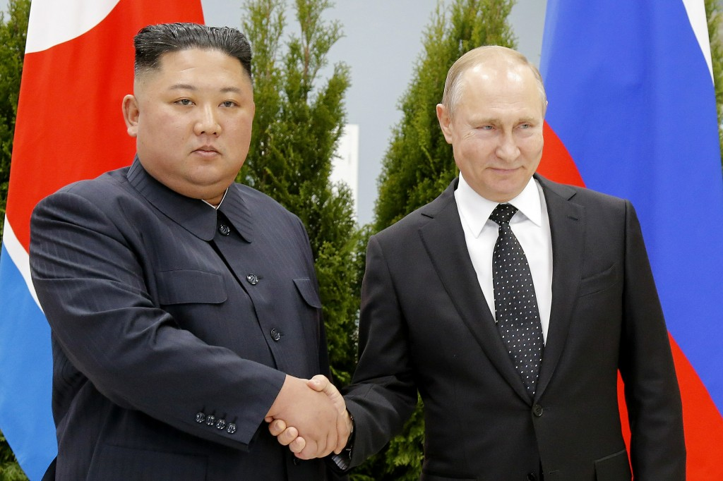 FILE - In this April 25, 2019 file photo, Russian President Vladimir Putin, right, and North Korea's leader Kim Jong Un shake hands during their meeti