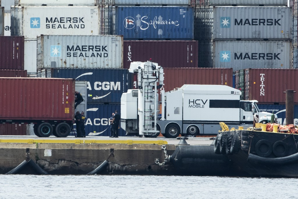 Authorities search a container along the Delaware River in Philadelphia, Tuesday, June 18, 2019. U.S. authorities have seized more than $1 billion wor...