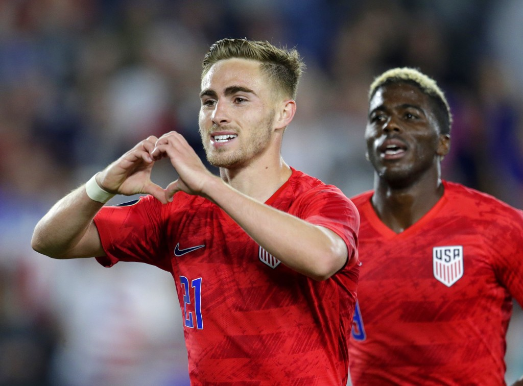 United States' Tyler Boyd, left, celebrates his goal against Guyana with fans as teammate Gyasi Zardes follows during the second half of a CONCACAF Go...
