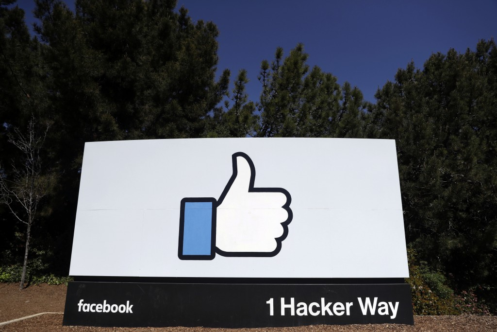 FILE - This March 28, 2018, file photo shows a Facebook logo at the company's headquarters in Menlo Park, Calif. Facebook's plan to create a digital c...