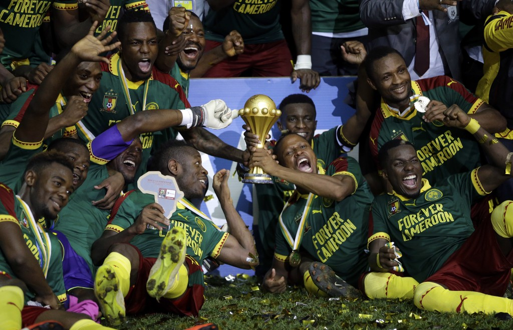 FILE - In this Sunday, Feb. 5, 2017 file photo, Cameroon players celebrate with the trophy after winning the African Cup of Nations final soccer match