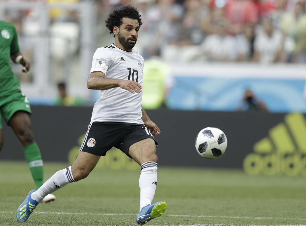 FILE - In this June 25, 2018, file photo, Egypt's Mohamed Salah chases the ball during the group A match between Saudi Arabia and Egypt at the 2018 so