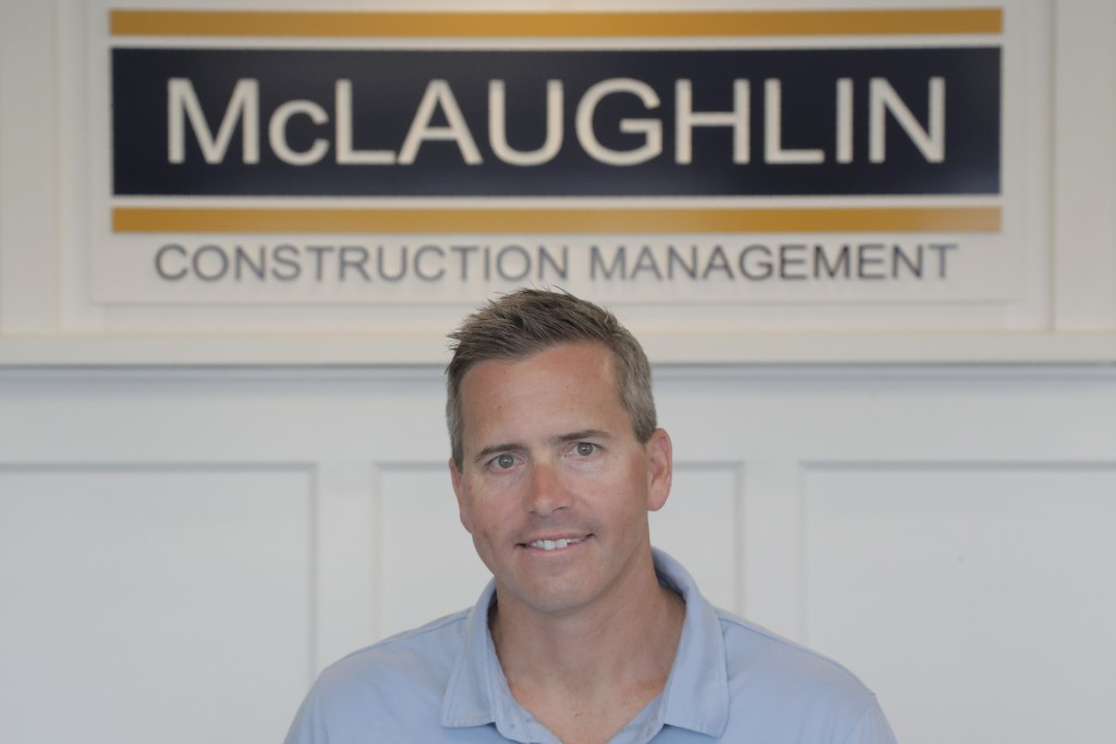 In this Wednesday, June 5, 2019, photo, Chris Carr, president of McLaughlin Construction Management, poses for a photo in Sea Isle City, N.J. When Jim...